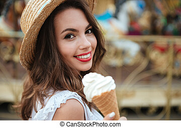 Close up portrait of a smiling girl with ice cream - Close...