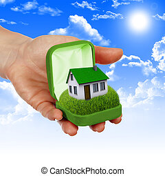 House in the hands against the blue sky - The House in the...