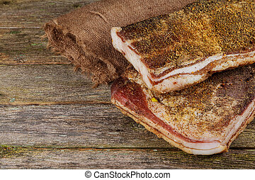 Salted pig fat with spices. Bacon, spices on a wooden Board....