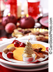 Place setting for Christmas with fresh fruits