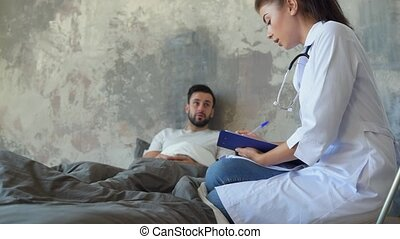 Female medical professional writing down symptoms of patient