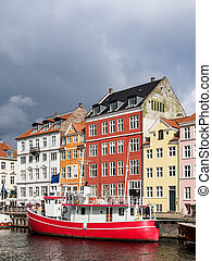 Nyhavn in the city Copenhagen, Denmark.