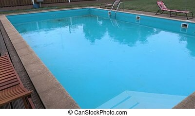 Swimming pool in rainy day