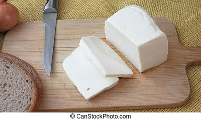 Goat cheese on a wooden cutting board. Proper nutrition....