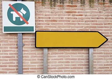 signs - two signs next to a brick wall