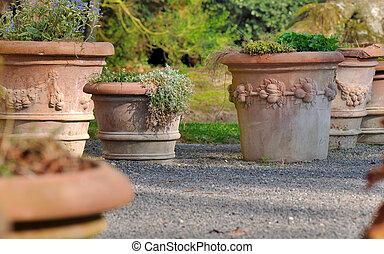 terracotta flower pots in garden