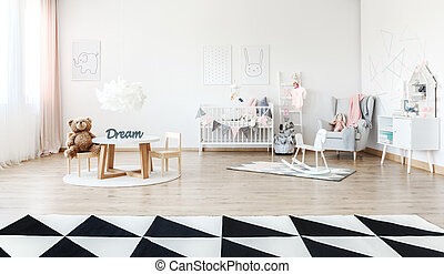 Child's room with small table - White rocking horse on rug...