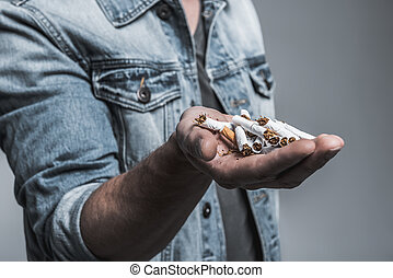 Young man is ready to stop smoking - Close up of male hand...