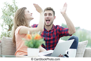happy young couple giving each other a high five. the...