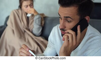 Worried young man having consultation with doctor on phone -...