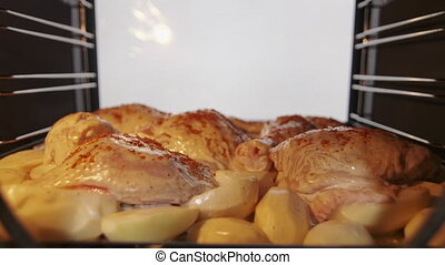 Making roasted chicken legs with potatoes baked in the oven...