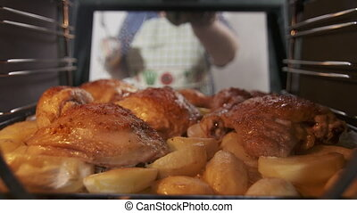 Making roasted chicken legs with potatoes baked in the oven....