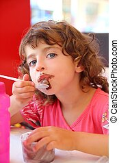 Girl eating chocolate ice cream dirty face having fun