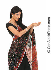 Woman in sari with holding action