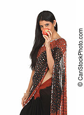 Lady in sari holding red apple