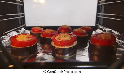Cooking roasted vegetable dish in convection oven timelapse....