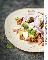 rustic mexican american pulled pork tacos - close up of...