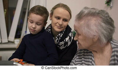 Woman with son visiting senior grandmother - Weak elderly...