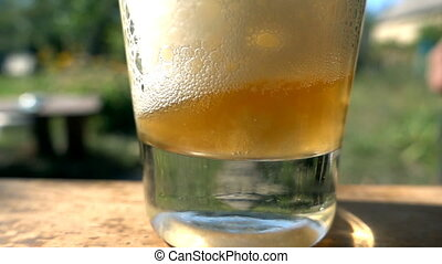 Beer poured into glass. slow motion - Beer poured into glass