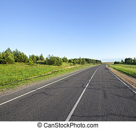 small asphalt road - A small asphalt road in the summer. The...