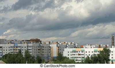 Time-lapse of running clouds over buildings - Time-lapse of...