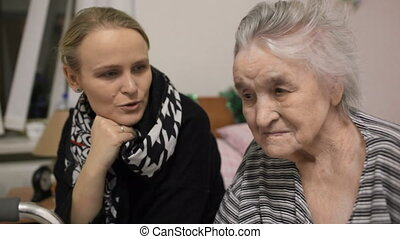 Elderly woman and her adult granddaughter - Granddaughter...