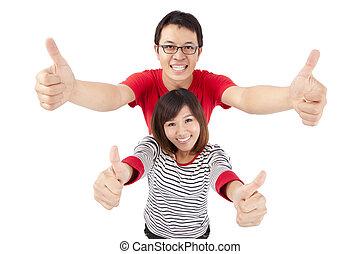 excitado, jovem, par, celebrando, polegar, cima