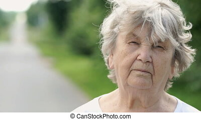 Portrait of serious mature old woman. Close-up