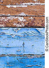 cracked paint, close-up - old blue paint cracked over time....