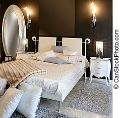 bedroom modern silver oval mirror white bed black wall
