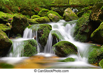 Waterfall on mountain stream in the National park...