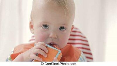 Cute boy drinking juice or milk from a packet. - Cute boy...