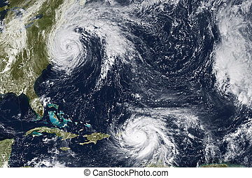 Hurricane Maria and Jose. Elements of this image furnished...