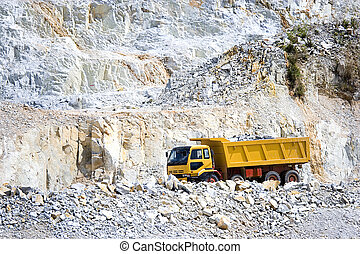 Yellow Truck at Quarry - Image of a yellow truck at a rock...