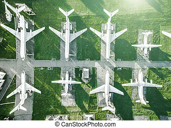 white planes on museum field, top view - white planes on...
