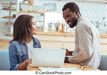 Pleasant woman showing project presentation to her colleague