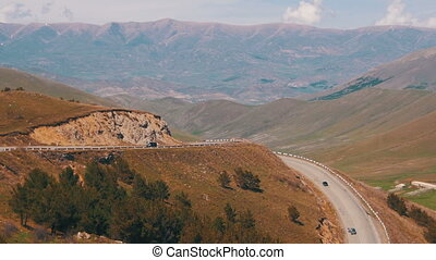 The Mountain Serpentine and Cars drive Along the Road in...