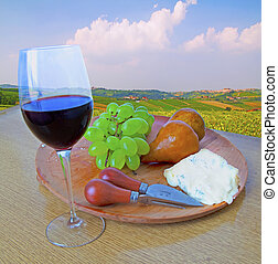 Cheese and grape and wine - Wooden plate with cutlery,...