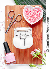 salt and cream for nail care in spa top view - salt and...
