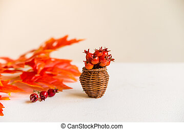 Hawthorn in vase and red maple leaves fall concept - Autumn...