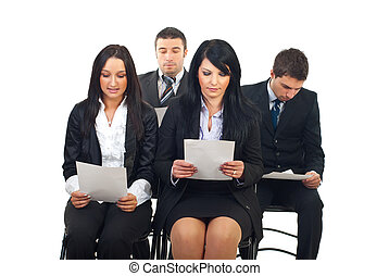 Executives reading at conference - Four executives people...