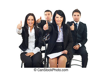Successful people at the conference sitting on chairs and...