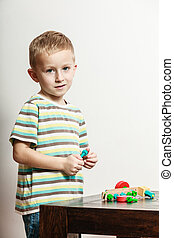 Little boy play with toy on table. - Spending free time play...
