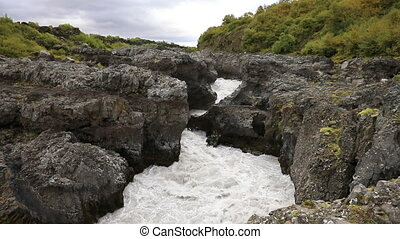 The upper reaches of the waterfall Barnafoss in Iceland