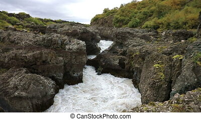 Waterfall Barnafoss in Iceland - The upper reaches of the...