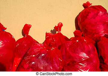 Group of Red Garbage Bags - Group of Red garbage bags in...