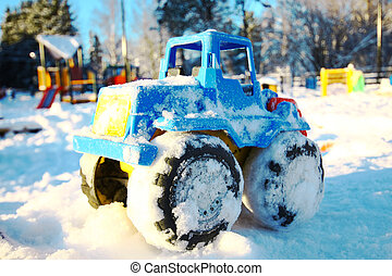 Toy vehicle in snow