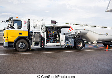 Fuel Truck On Wet Runway At Airport - Fuel truck on wet...