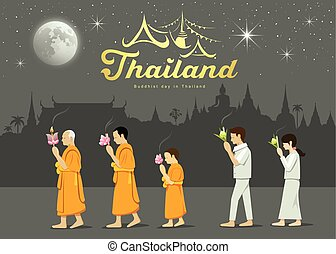 Buddhist monks and people worshipers on important Buddhist...