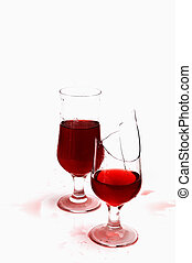 broken glasses wine and drops - Two glasses with wine and...